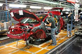 bmw factory assembly line nissan suspends japanese production line due to faulty inspections