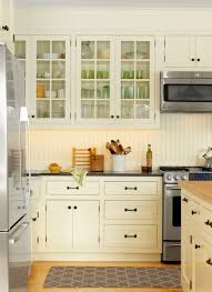 lovely white kitchen cabinets with beadboard doors kitchen craft