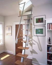 gorgeous stairs to attic ideas with frame on the wall beside stair
