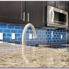 black glass backsplash kitchen awesome blue glass backsplash tile with black cabinet 8520