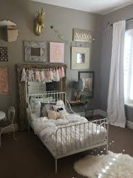 sweet girls bedroom with pink accents color and patterned bedding