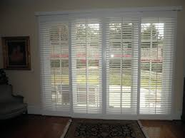 sliding glass doors with blinds between pergola home office