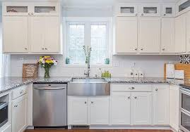 white kitchen cabinet with glass doors how to utilize glass front cabinets in your kitchen
