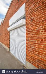 rolling garage doors residential industrial roll shutter garage door brick wall urban setting