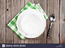 plate table top empty plate and spoon on wooden table top view stock photo