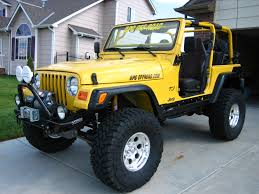 lifted jeep truck i love jeeps yellow jeep wrangler with nice tires t h i n g s