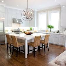 L Shaped Kitchen Islands With Seating L Shaped Kitchen Layout With An Arched Overhang On The Island