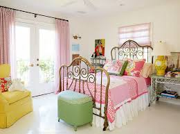 lovely shabby chic bedroom with metal bed and colorful accents