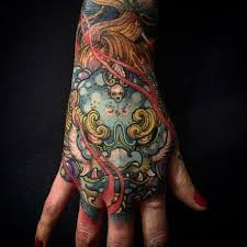 traditional foo dog head tattoo on man right hand