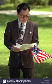 Flag Suit South Vietnamese Man In Suit Holding Program And Flag At Memorial
