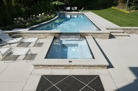 In Pool Chaise Lounge Striking New Trends In Pool Tile With Coral Stone Pool Deck Also