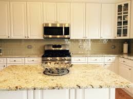 khaki glass tile kitchen backsplash with white cabinets u0026 granite