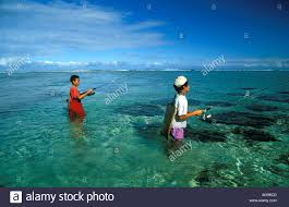 children fishing in lagoon reunion island stock photo royalty