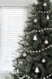minimal scandinavian christmas tree garlands ornament and rose