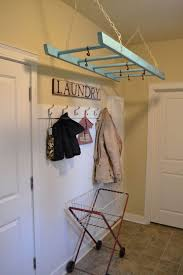 furnitures wall mounted clothes drying rack how to build diy practical laundry rack designs that dont stand out furnitures suspended ladder with hooks wall mounted clothes