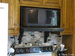 Microwave In Kitchen Cabinet by Microwave Shelf Update Microwave Shelf Shelves And Stove