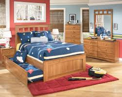 bedroom oak wood trundle beds with decorative bedding and dresser