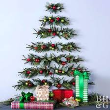 how to put christmas lights on your wall how to put christmas lights on a tree correctly cut down evergreen wall