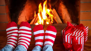 feet in christmas socks against fireplace stock video footage