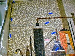march 2013 mosaic art now blue tape shows where the magnet attracted to the bolts used to mount the mural to the wall