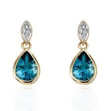 9ct gold earrings 9ct gold london blue topaz diamond drop earrings c k jewellers