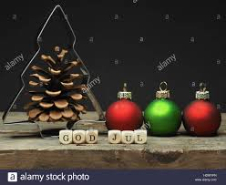 baking tin tree shape with small wooden dices and the words god