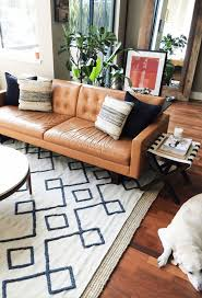 5 ways to style a camel leather sofa mid century living room