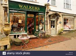 pretty antique shop front in burford cotswold stock photo royalty