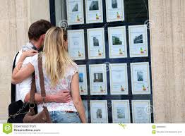 couple looking at real estate ads in the street stock photo