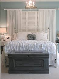 bedroom design with tasteful antique white master iron bed