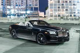cars rolls royce rolls royce dawn black miami exotics exotic car rentals