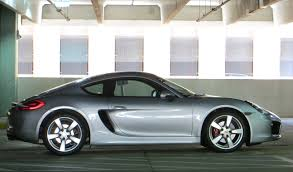 porsche side view side view photo of a cayman s on standard suspension