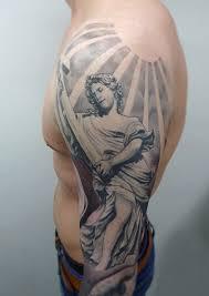 religious sleeve tattoo by tamas dikac tribal body art