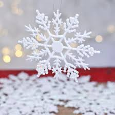 white iridescent glittered snowflake ornaments snow snowflakes
