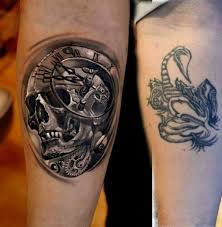 cover up scorpion with black and grey sugar skull tattoos