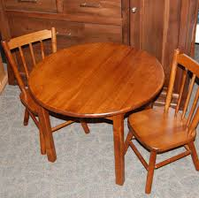 children u0027s round table and chair set shown in brown maple with a