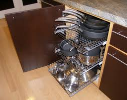 all our pots pans and lids are organized for easy retrieval