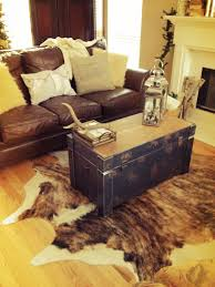 decorating traditional dining room design with pedestal dining storage coffee table on cow hide rug and
