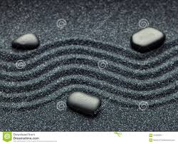 zen garden with a wave lines in the sand with relaxing massage