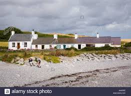 moelfre anglesey north wales uk row of white cottages beside isle