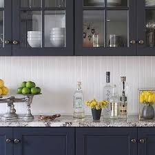 white kitchen cabinets with gray granite backsplash transitional