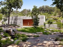 nestled at the confluence of two creeks on a texas hill country