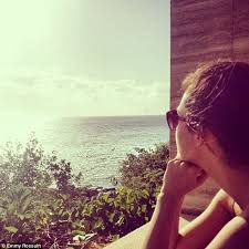emmy rossum enjoys beach life in a series of sun kissed snaps