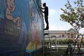sebastien walker paints the carlsbad art wall on march 26 27 2016 parisian muralist sebastien walker painted the carlsbad art wall transforming the east facing exterior wall of