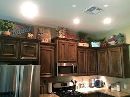 decorating ideas for the top of kitchen cabinets pictures kitchen cabinet decorating ideas riffcreative co