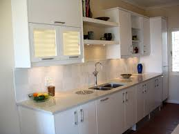 Shelf Above Kitchen Sink by Open Shelving Above Sink Area And Lighting Under The Cabinets