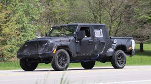 jeep gladiator 1967 jeep wrangler pickup spied up close riding high