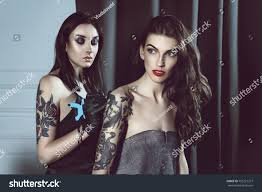 beautiful woman tattoo artist does tattoo stock photo 705221377