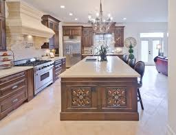 ornate wooden carved kitchen island for luxury kitchen floor plan