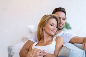 where to buy free hug sofa a beautiful young woman lying on the sofa with boyfriend hugging